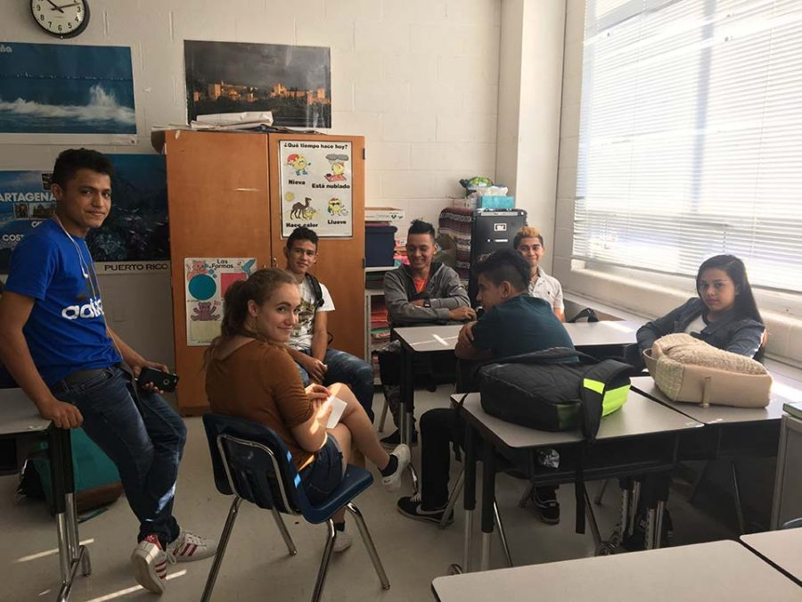 Spanish Honor Society ESOL Officer, Zoe Ziff ('17), discusses Homecoming with students in Maria Sanchez's Warhawk Time.