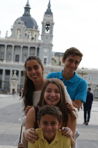 Alex Costanza (middle) poses with her host family siblings in front of the Almudena Cathedral. (Top to bottom: Pablo, Maria, Costanza, Nacho)