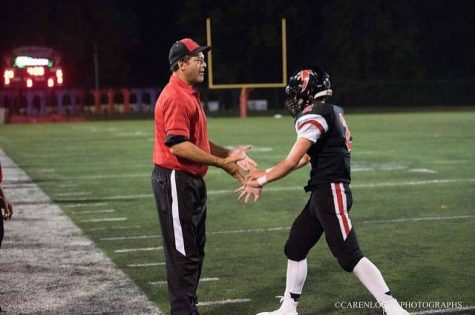 Lenny Schultz greets Wiley Counts after a play.