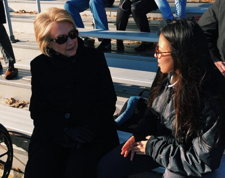 Khuska Jargalan (19) talks to Clinton.
